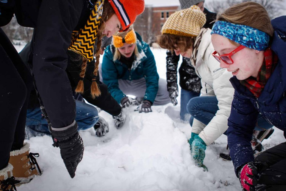 Morgan Magid, Jared Kaufman, Brooke Auer, Taylor Ysteboe, Erin Bormett and Anna Maples (left to right) help each other build a fort on the quad. The freshmen spent their snowday taking part in the snowball fight at noon. Photo by Tanzi Propst.