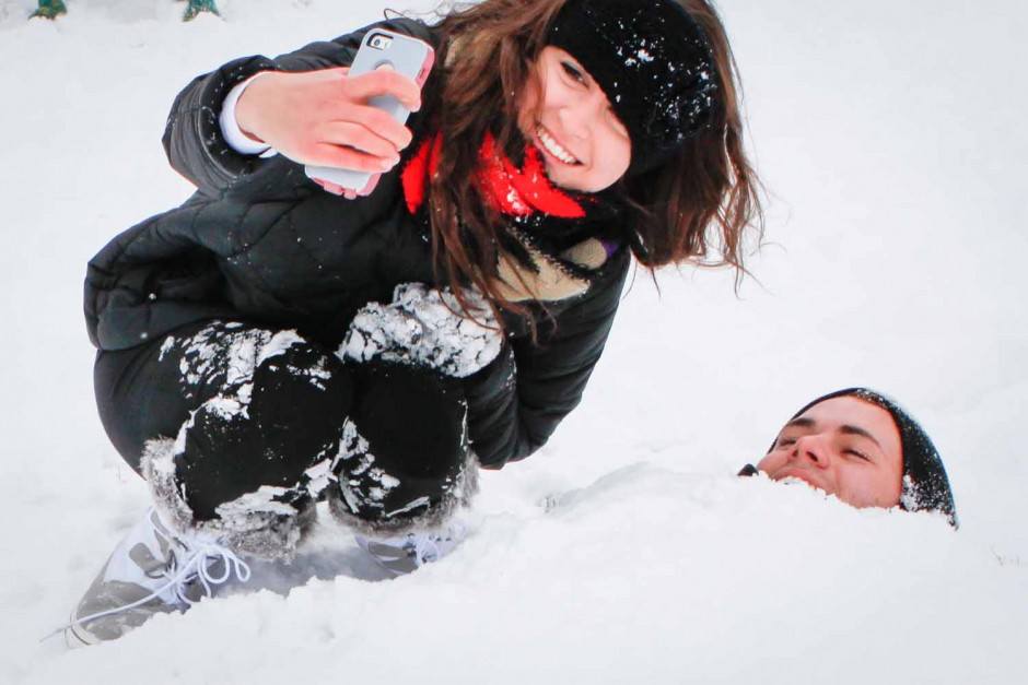Madison Stanze takes a selfie with her boyfriend, Austin Schlager, for Snapchat. Stanze had buried Schlager in the snow for fun. Photo by Tanzi Propst