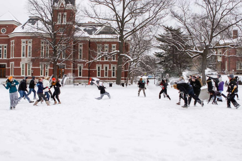 Students on the Quad took sides and began a snowball fight. The event went in spurts, depending on how fast each team could recreate snowballs. Photo by Tanzi Propst.