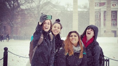 Students taking a selfie in the snow.
