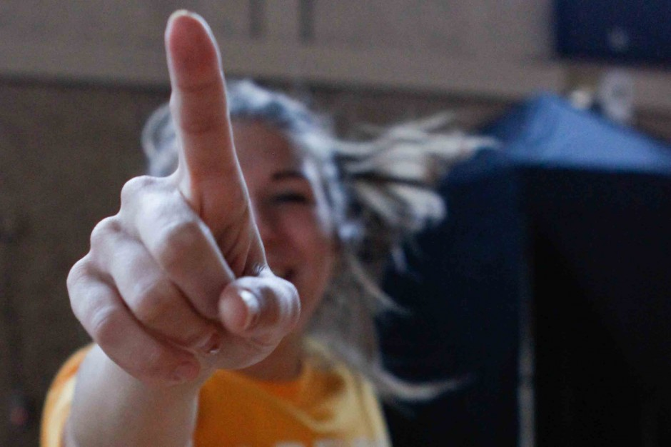 Dancer making No. 1 sign with her finger.