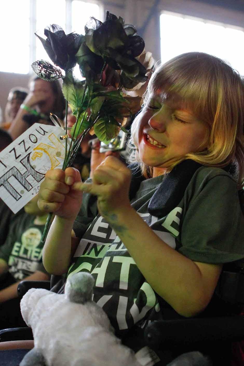 Girl holding flowers.
