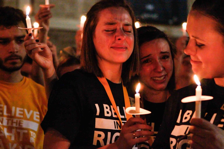 Shelby McGee and Amanda Gingrich holding candles.