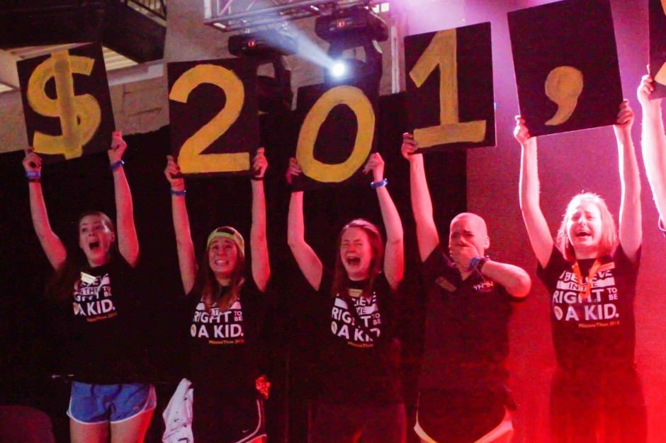 MizzouThon leaders hold up numbers reading $201,322.68.