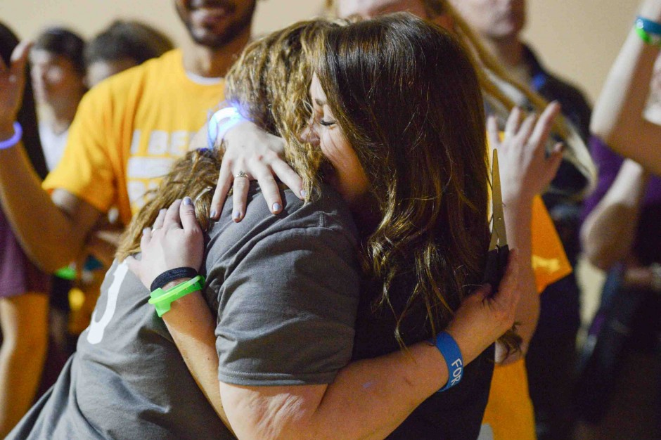 Alexis White hugging the mother of a Miracle Child.