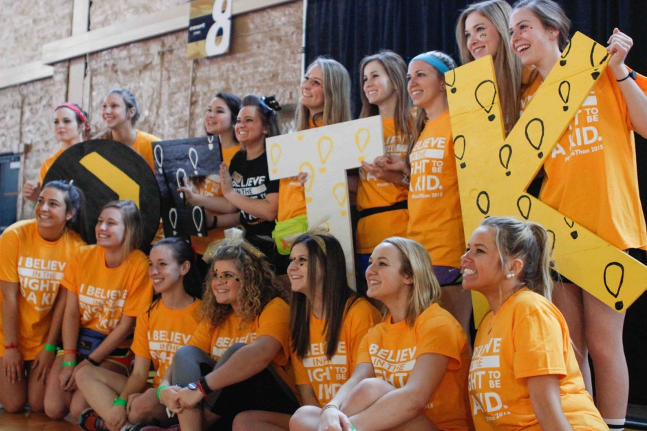 Students pose with giant FTK letters.