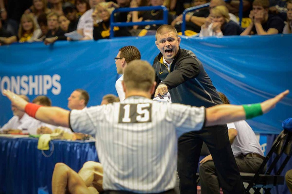 Head assistant coach Alex Clemsen points out a move in Drake Houdashelt's match against Purdue's Brandon Nelson.