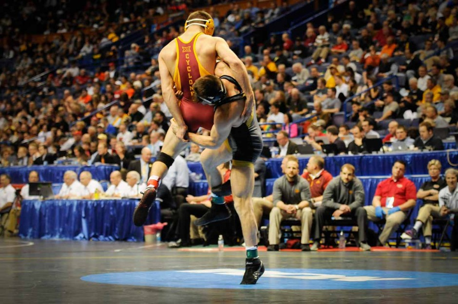 Senior Johnny Eblan takes Iowa State's Tanner Weatherman to the mat on his way to a 8-0 major decision win in the 174-pound weight class.