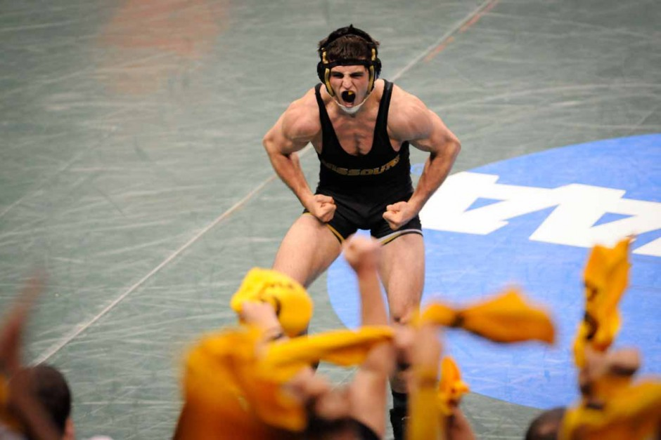 Willie Miklus celebrates a win by pin against Wisconsin's Richard Roberston in the 184-pound division.