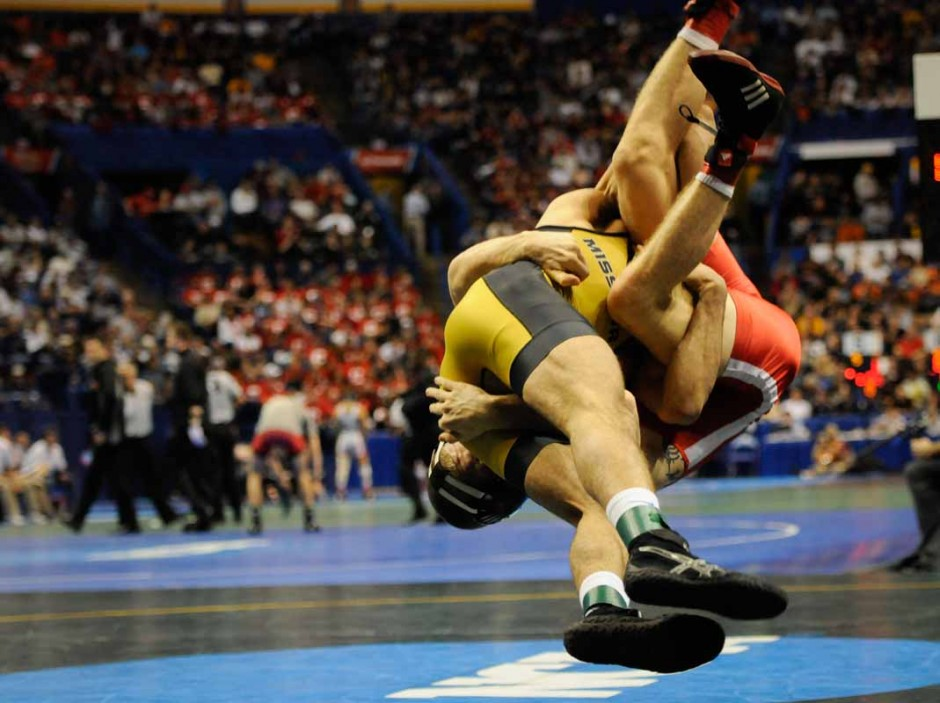 Lavion Mayes lifts Nebraska's Anthony Abidin in a 141-pound match on Friday night. Mayes won with a 16-8 major decision and earned himself All-American status.