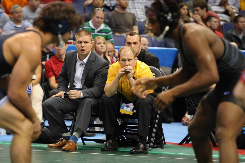 Head coach Brian Smith and head assistant coach Alex Clemsen keep an eye on J'Den Cox on Saturday morning in his fifth match of the tournament against Penn State's Morgan McIntosh.