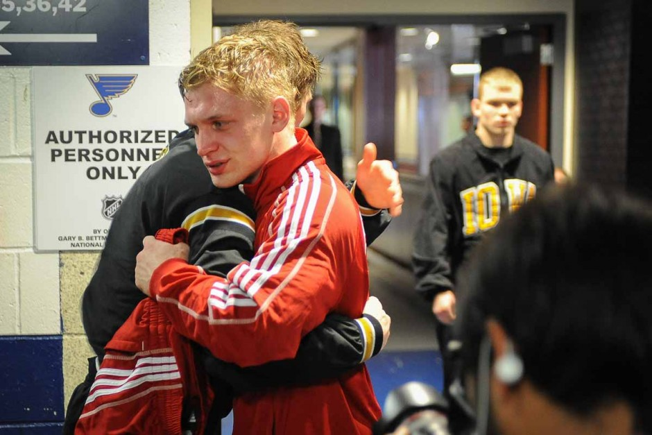 Drake Houdashelt hugs competitor David Habat (Edinboro) after their match for the national title where Houdashelt won in sudden victory for a 3-1 final score.