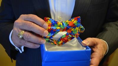 Chancellor Loftin holding a bow tie.