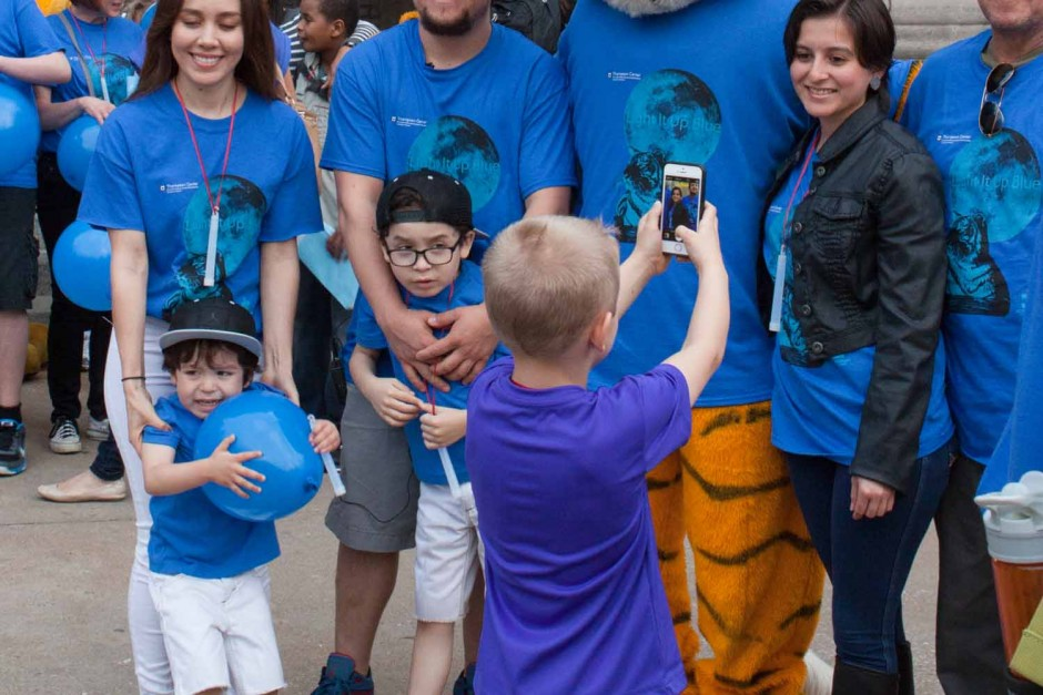 Francisco Lopez's family poses for a photo with Truman the Tiger at Memorial Union just after the conclusion of the Light It Up Blue event, Thursday, April 2, 2015.