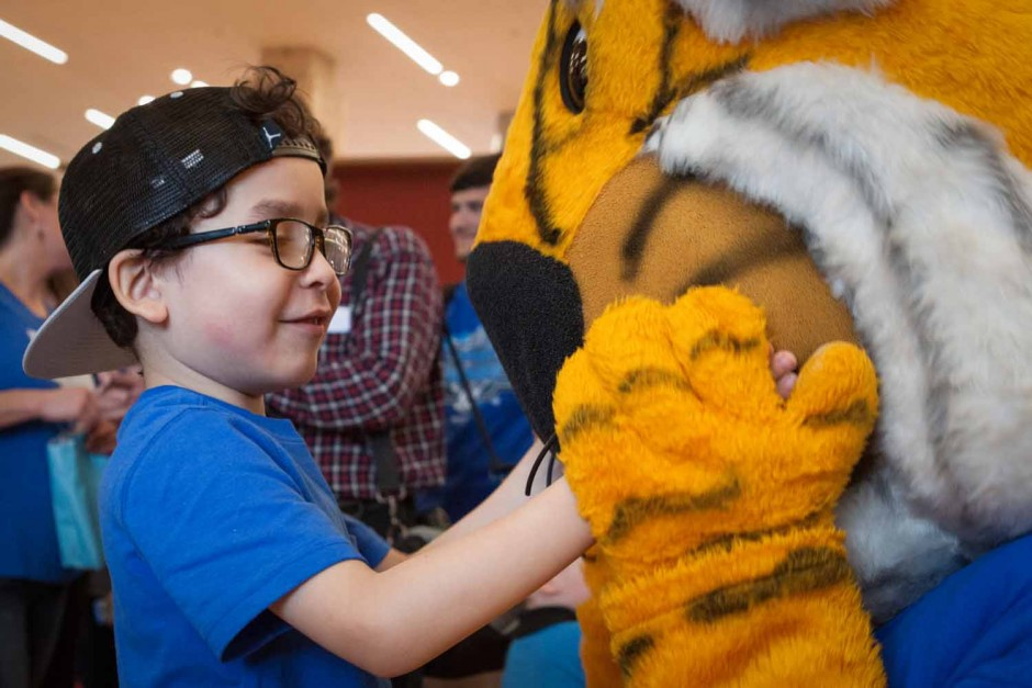 Francisco Lopez, 7, discovers the multiple textures of Truman the Tiger at Light It Up Blue, Thursday, April 2, 2015.