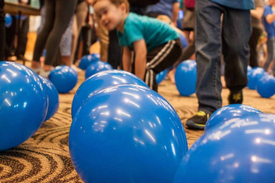 Parents and kids were allowed to play with and keep the balloons that had been released after the ribbon cutting at Light It Up Blue, Thursday, April 2, 2015.