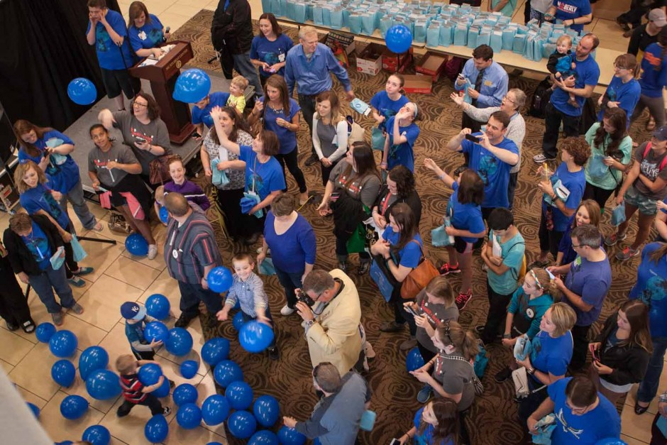 Blue balloons fall from the second floor of the Student Center. The balloons were released simultaneously with the ribbon cutting ceremony.