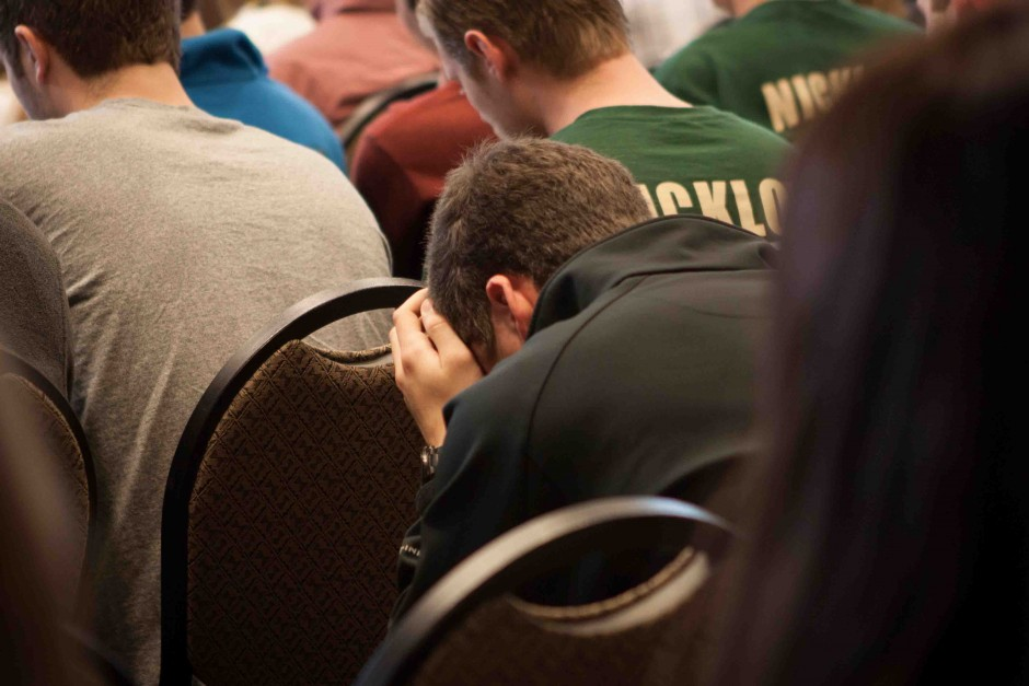 Jack Zimmerman, 18, rests his head in his hands. He attended the ceremony in honor of Jack Lipp.