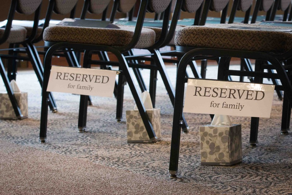Boxes of tissues were placed under chairs reserved for family members in the front rows of Stotler Lounge.