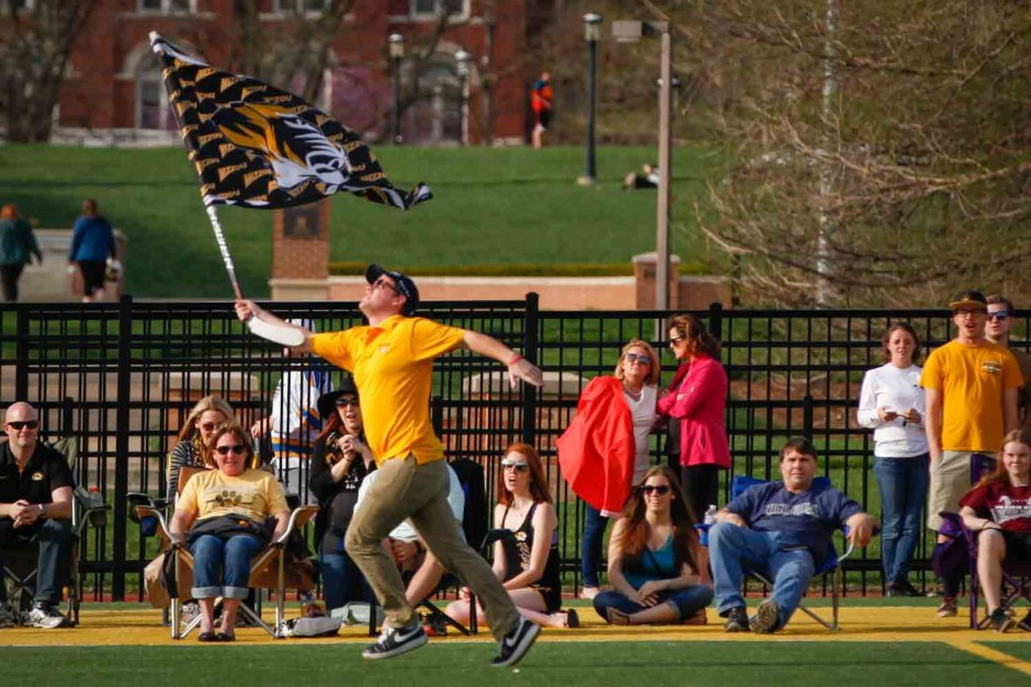 Robbie Shutt runs the length of the field for each goal scored by the men's lacrosse team. Shutt helped to keep the energy high among fans.