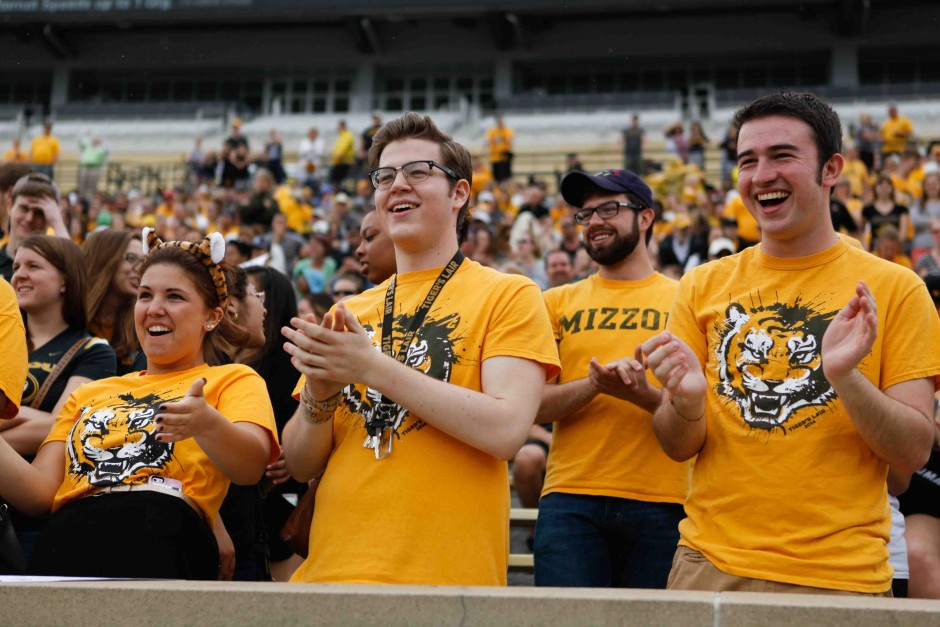 (From left to right): Taryn Herbst, freshman, Chris Green, sophomore, and Ryan Layton, freshman, cheer during the first play of the spring game. The students sat in the Tiger's Lair section of Memorial Stadium and stayed through the end of the game.