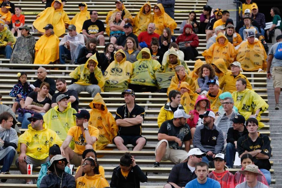 Fans in rain ponchos.