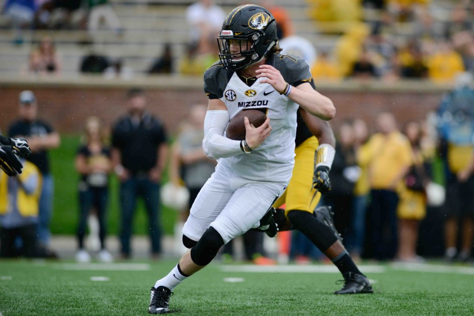 Maty Mauk runs the ball during the second half. All quarterbacks wore white during the game and could not be tackled.