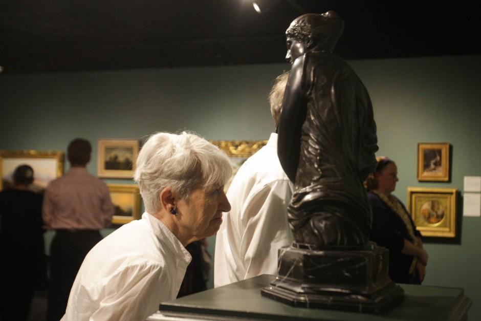 woman looking at bronze