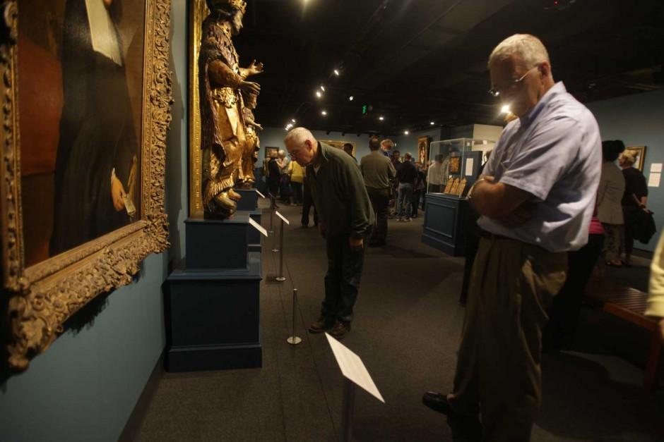 Men looking at paintings.