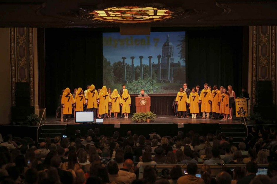 People in yellow robes.