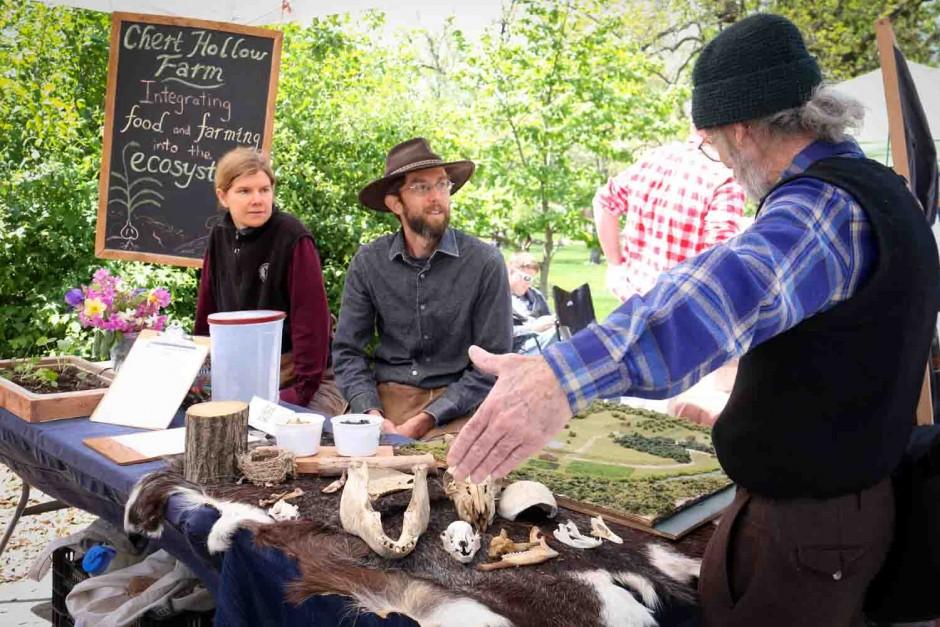 Eric and Joanna Reuter of Chert Hallow Farm explain a plot of land to Brandon Smith.