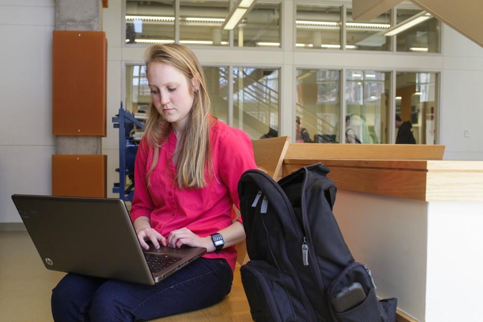 Paige Martz on a laptop.