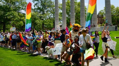 Students with rainbow flags on campus.