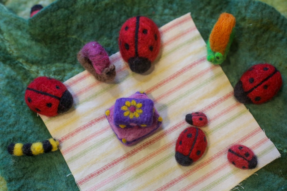 Felted play sets made by Kate Akers from MU Extension sit on display at the 2015 Mu Arts and Crafts Showcase. Each playset is made up of a collection of small, handmade pieces.