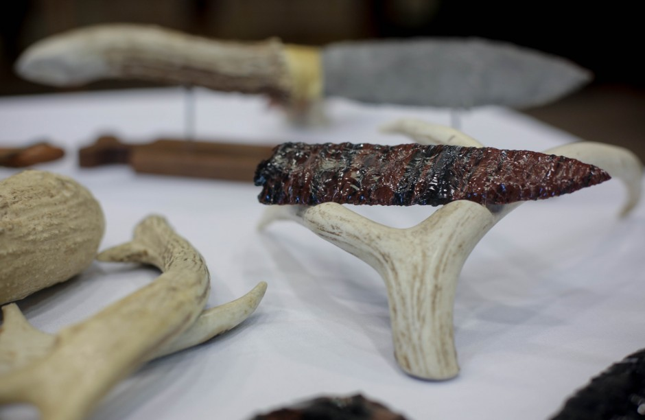 Handmade tools and weapons made by ____ from ____ stand on display at the 2015 MU Arts and Crafts showcase. ____ employs the process of Flintknapping, which is the use of percussion and pressure-flaking techniques to chip and shape stone to create his tools.