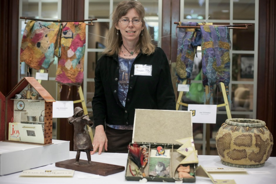 Fiber Artist Amy Shomaker from the MU School of Journalism stands infront of her exhibition table at the 2015 MU Arts and Crafts Showcase.
