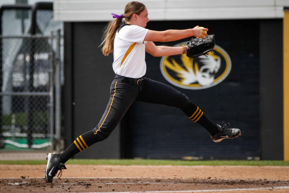 Tori Finucane, No. 5, winds up to pitch the ball during the beginning of the game. Finucane is a sophomore and serves as the Tigers' right-handed pitcher.