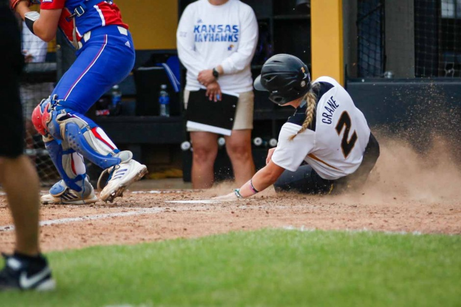 Emily Crane sliding into home base.