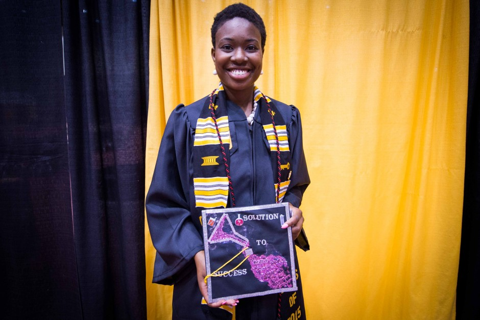 Maureen Tanner, a biochemistry major, shows off her solution to success mortarboard.