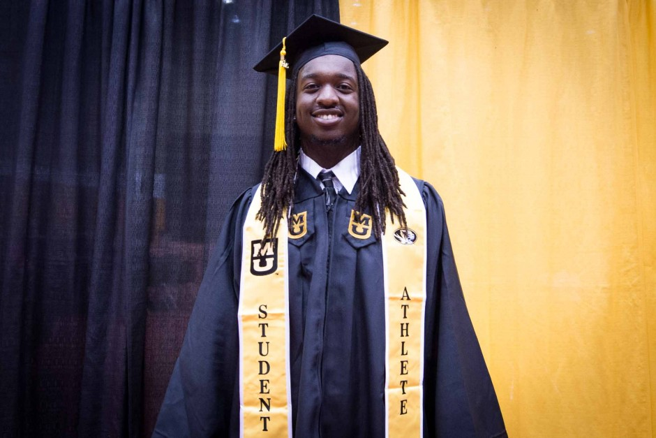 Clarence Green, a linebacker for the football team, shows off his student athlete regalia.