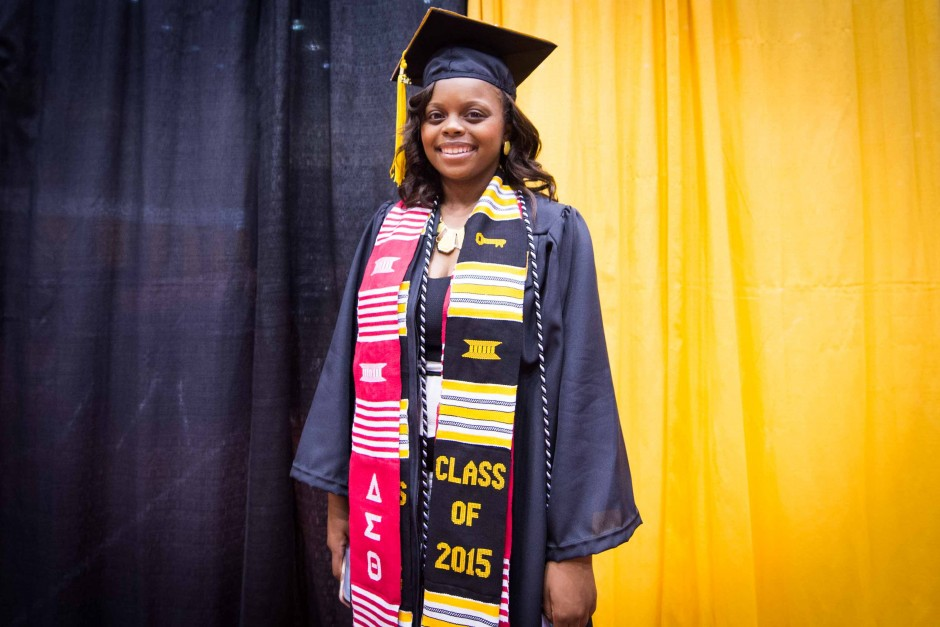 Ashley Smith, a hospitality management major, poses for a portrait before walking in commencement ceremonies at the Hearnes Center.