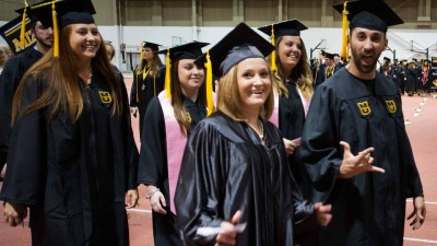 College of Agriculture, Food and Natural Resources students march out of the Brewer Fieldhouse and enter the Hearnes Center for commencement ceremonies.