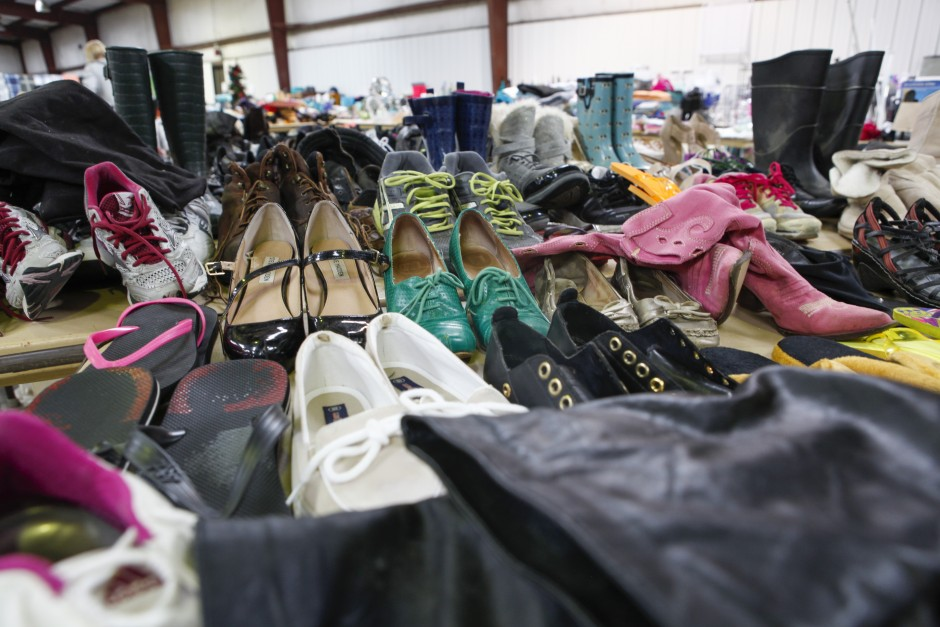 A seemingly endless supply of shoes sit on multiple tables inside the Mizzou surplus property warehouse, Wednesday, May 20, 2015. The variety ranges from sandals, to rain boots, to tennis shoes, to high heels and more.