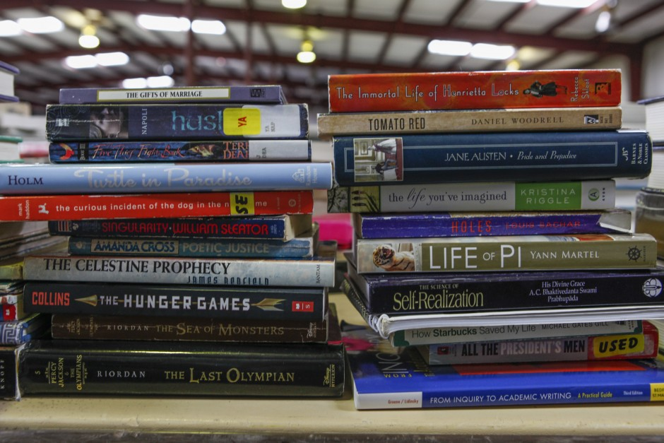 "Stacks of books, both for academic and leisure, line a table near the office supplies, ready to be sold during the Tiger Treasures Rummage Sale on Saturday, May 30, 2015. Books ranging from used textbooks to more modern reads like ""The Hunger Games"" can be found."