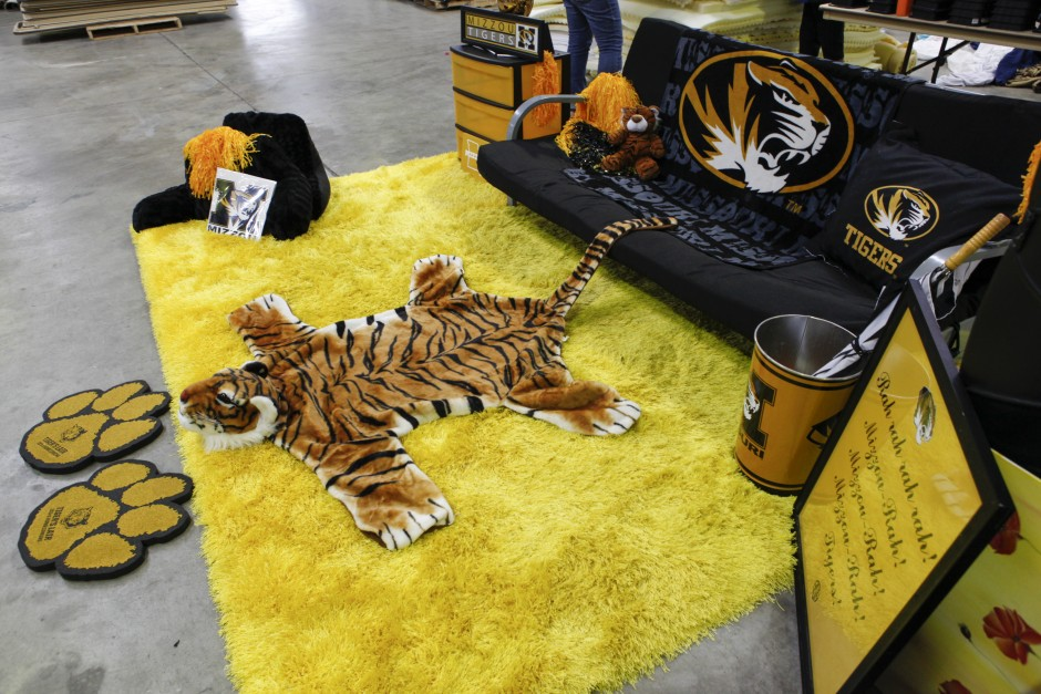 A mock living room arangement, themed Mizzou, is set up and hoped to be sold at the Tiger Treasures' Rummage Sale on Saturday, May 30, 2015. The arrangement includes wall decorations, a rug, a futon, pillows, a blanket and more.