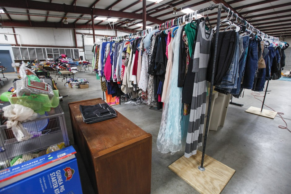 "Jeans, an Elsa costume and various shirts hang from a clothing rack near stuffed animals and a table of reusable tote bags in Mizzou's Surplus Property's warehouse. ""All the items are priced to sell,"" Julie Alexander, executive director for the University YMCA, said. ""We don't want to price-gouge anyone. We're helping send kids to camp and keeping this stuff from going to a landfill. It's a win-win for everyone."""