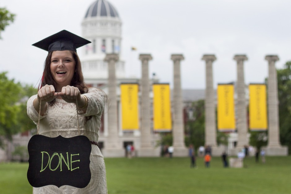 Madison Stegeman, a Missouri School of Journalism graduate, poses with a home-made sign on the Quad.