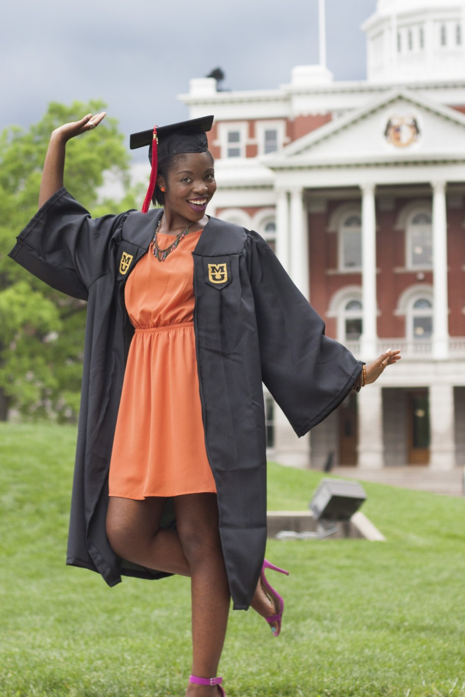 Angela Pearson, a soon-to-be Journalism and Political Science graduate, poses for grad photos with her friend on the Quad.