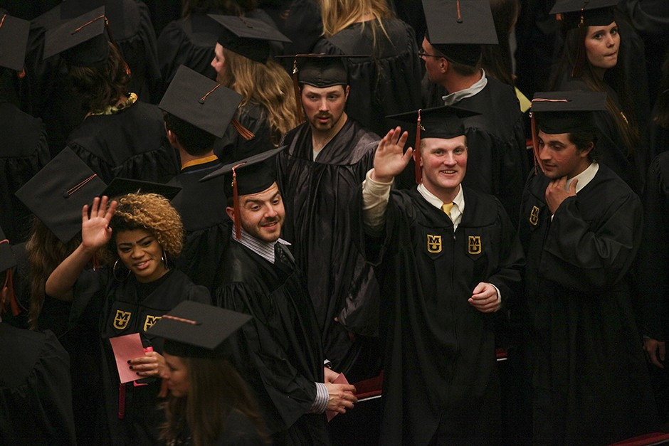 Before receiving their diplomas and becoming Mizzou alumni, School of Natural Resources students turn and wave to friends and family who have supported them while earning their degrees. Photo by Tanzi Propst.