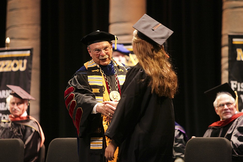 Chancellor Loftin and student.